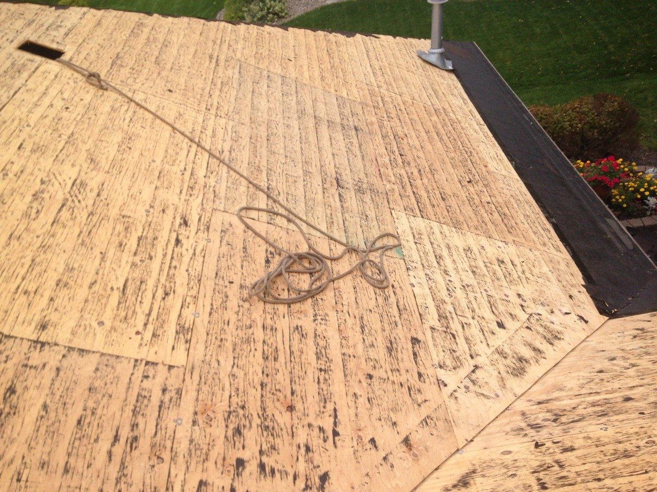 Roof tear off project with sheathing exposed ready for underlayment