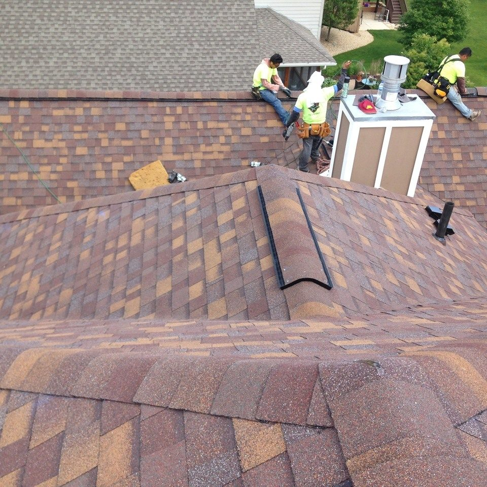 Local crew on roof installing flashing on residential home